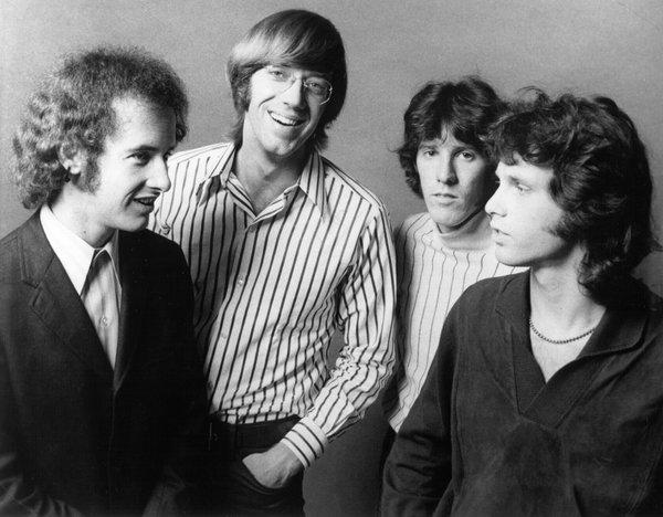 The Doors (L to R, Robby Krieger, Ray Manzarek, John Densmore and Jim Morrison)